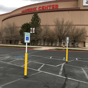 "Impact Recovery Systems Sta-Rite 78"" Sign Post With Bollard in Parking Lot with Parking Sign"