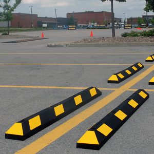 NoTrax Safety 6' Black/Yellow Recycled Rubber Car Stop In Parking Lot