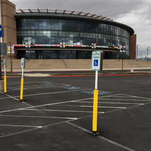"Impact Recovery Systems Sta-Rite 78"" Sign Post With Bollard in Parking Lot with Parking Lot Signs"