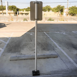 "Impact Recovery Systems Sta-Rite 102"" Sign Post Without Bollard In Parking Lot"