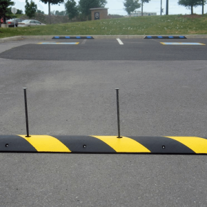 NoTrax® 4' EasyRider Recycled Rubber Speed Bump In Parking Lot With Pins
