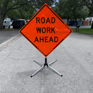 48 x 48 Lane Ends Merge Right Reflective Vinyl Roll Up Sign on Sign Stand Action