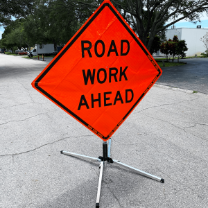 48 x 48 Road Work Ahead Vinyl Roll up Sign on Sign Stand Action Side