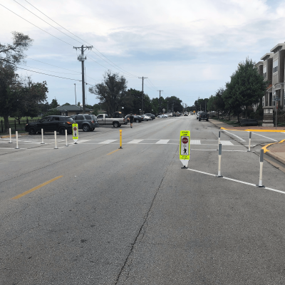 Impact Recovery Systems In-Street Stop For Pedestrian Crosswalk Sign with Delineators